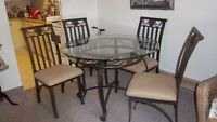 Glass top table set with 4 chairs
