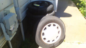 Almost new tires with rims, Ford hubcaps and convenience spare