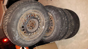 4 x 195/70R14 winter Goodyear Nordic tires with rims