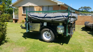 camp trailer sleeps up to 12 people must go!