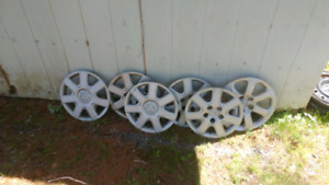 15 in hubcaps with mazda symbol