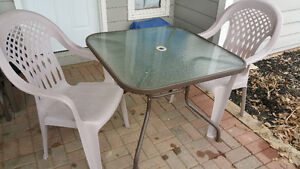 Patio Table and 2 stacking High Back chairs. $60.