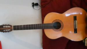 Acoustic guitar with case 50$