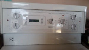 24 inch white electric stove with digital clock and timer
