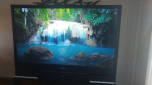 """Samsung 67"""" TV, stand and DVD player"""