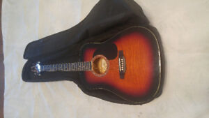 Acoustic Guitar with accessories, adult size, mint condition