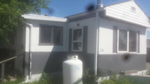 Mobile home swap between Calgary home and Cape Breton home/land