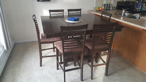 Dark wood bar table with butterfly leaf + 6 chairs