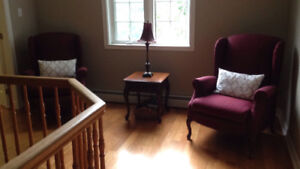 Two wine coloured wing back chairs that recline for 200.00