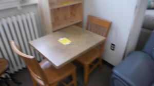 Table and two chairs $149. , Table and four chairs $169.