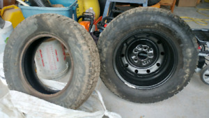 Two practically brand new winter tires 1 rim.