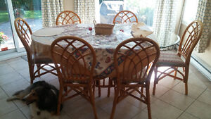 Superb glass table top with beautiful bamboo cushioned chairs. West Island Greater Montréal image 1