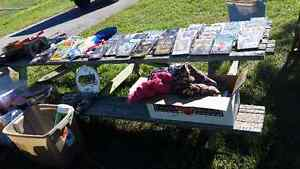 Yard sale with tons of movies and books
