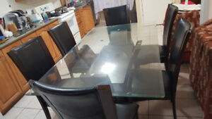 Glass top dining table with six chairs