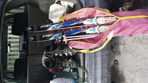 Downhill skis , boots and poles