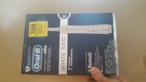 Brand new oral b white 7000 electric toothbrush