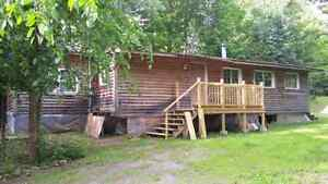2 bedroom trailer on 1 acre lot AS IS