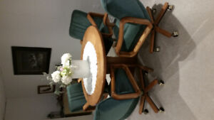 Solid oak table and 4 matching chairs