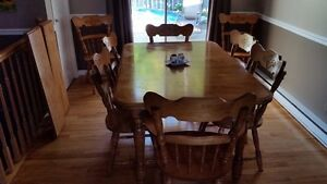 Dinner table (with two leafs) and Eight Chairs