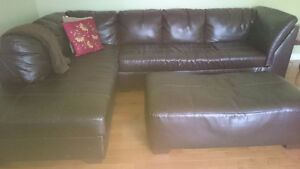 Nice leather sectional and ottoman