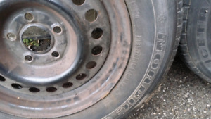 2 ice radials on rims chev cavilier