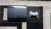 PS3 with one controller and over 25 games.