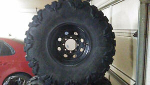 "Nitto Mud Grapplers 385/70R16 (37.8""x15.4"") on rims"
