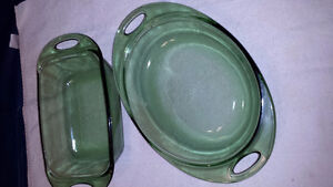 Two emerald green Anchor Hocking dishes with cutout handles.