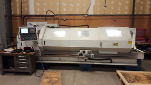 As NEW ROMI M27x120 CNC lathe