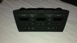 A4 B7 OEM A/C Control unit with seat warmer switches.