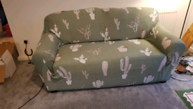 Faux leather 2-seater sofa with cactus fabric cover