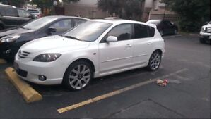 Pearl white Mazda 3 GT priced for quick sale.