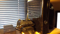 Xbox 360 slim, Coltroller with chat pad, and 7 games