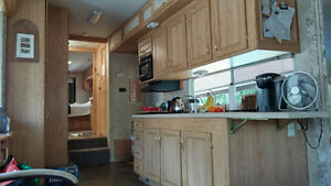 Trailer on beautiful lot at Woodland Family Campground