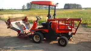 Tracteur  kubota  cueille use  a bleuets