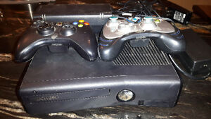 Xbox 360 good condition plus 2 controllers plus one game