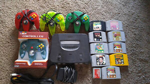 Nintendo 64, 2 controllers, cords, memory card, 9 games
