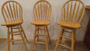 Wooden swivel bar stools for sale.