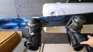 Lamar snowboard and boots with flow bindings