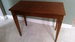 Piano or organ bench.  Solid wood. Very sturdy.