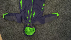 SZ 4 excellent condition winter jacket. Navy and green color