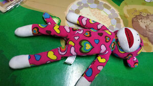 Sock Monkey sed in Great conditiondoll pink with heart design$5