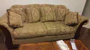 Two seater  with carved wood in mint condition,very comfy from a