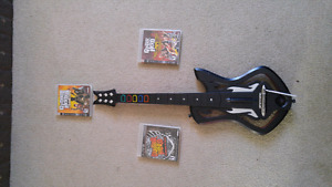 Ps3 Wireless guitar with 3 games.