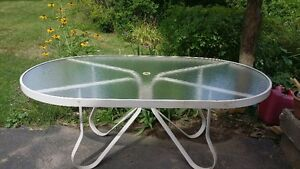 large glass topped patio dining table