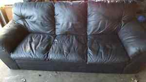 BLACK LEATHER COUCH. DELIVERY IS EXTRA