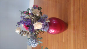 Vase with bouquet of flowers