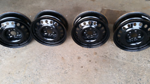 4 steel rims 5 hole 17 in. 5x115. Great condition