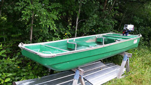 colmen flatbottom boat with 5 horse power nissan moter