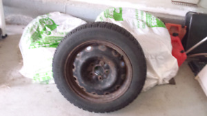 Set of used Goodyear Nordic winter tires on rims